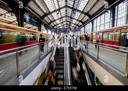 Blurred motion image of passengers on platforms at Friedrichstrasse railway station on the S-Bahn in Berlin Germany - Stock Photo