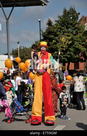 Gorton, Manchester, UK. 7th Sep, 2014. Gorton Carnival Parade on way to Debdale Park, with a stop on Tesco car park, - Stock Photo