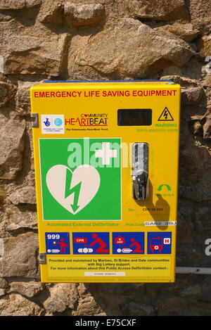 A defibrillator on a wall near Marloes, Pembrokeshire, West Wales, UK - Stock Photo