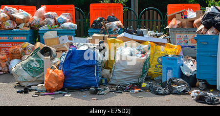 Local Authority unmanned roadside collection dump for recyclable rubbish overloaded after weekend - Stock Photo