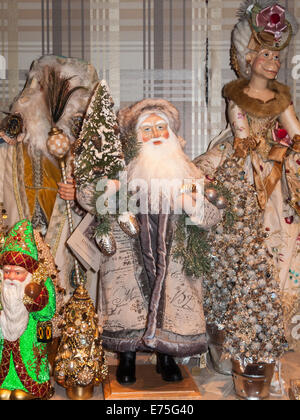 Traditional Santa Claus / St Nicholas Father Christmas figure in a festive shop display in Manhattan, New York - Stock Photo