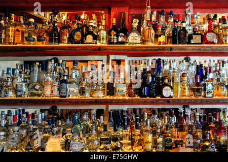 Over 200 bottles of Tequila cover  the walls of a bar in Sayulita Mexico - Stock Photo