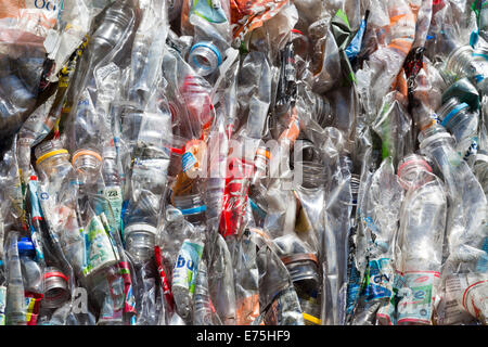 Flattened and compressed cubes of plastic bottles - Stock Photo
