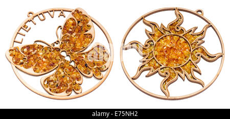 VILNIUS, LITHUANIA – JULY 27, 2014:  Wooden souvenirs of Amberart  brand are decorated with amber jewels stones. - Stock Photo