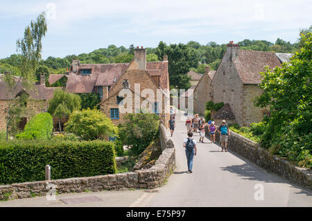 Group of walkers crossing the bridge over the river  Sarthe at Saint-Céneri-le-Gérei, Orne department, France, Europe - Stock Photo