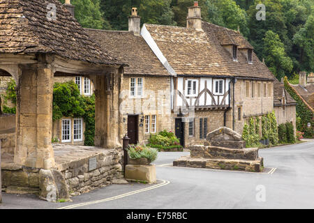The Village of Castle Combe and Market Cross regarded by some as 'The Prettiest Village in England',  Wiltshire, - Stock Photo