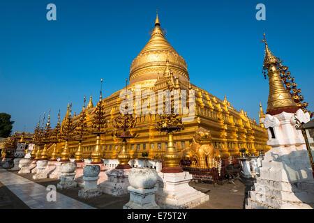 Golden chedi, Shwezigon Pagoda or Shwezigon Paya, Nyaung U, Mandalay Region, Myanmar - Stock Photo