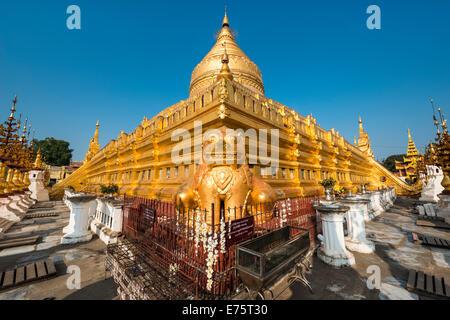 Golden lion or chinthe, golden chedi, Shwezigon Pagoda or Shwezigon Paya, Nyaung U, Mandalay Region, Myanmar - Stock Photo