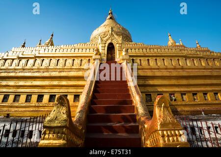 Golden chedi, red staircase, Shwezigon Pagoda or Shwezigon Paya, Nyaung U, Mandalay Region, Myanmar - Stock Photo