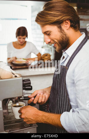 Barista making a cup of coffee - Stock Photo