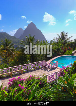 Gros Piton and Petit Piton, volcanic cores, pool and terrace of the La Haut Resort at the front, Lesser Antilles - Stock Photo