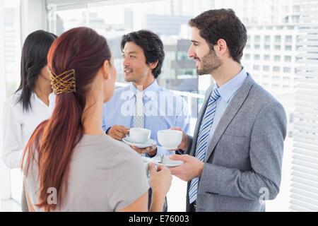 Business team enjoying some drinks - Stock Photo