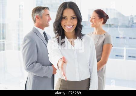 Businesswoman offering a friendly handshake - Stock Photo