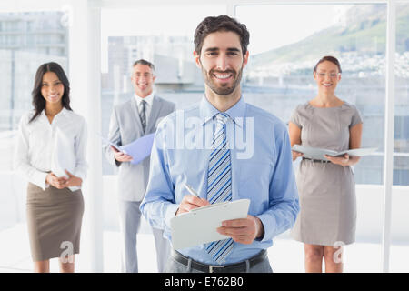 Business woman holding a clipboard - Stock Photo