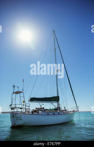 Sailboat in water on sunny day - Stock Photo