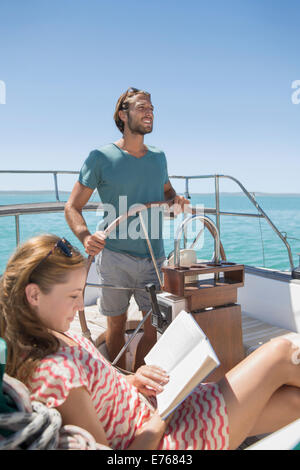 Couple relaxing in boat on water - Stock Photo