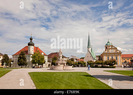 Kapellplatz square with fountain of  Mary, Town Hall, church Magdalenakirche and the Chapel of Grace in Altoetting, - Stock Photo