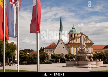 fountain  of Maria, church Magdalenakirche and the Chapel of Grace on Kapellplatz square in Altoetting, Upper-Bavaria, - Stock Photo