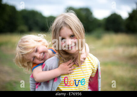 Siblings Outdoors - Stock Photo