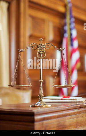 Scales of justice on the judge's bench - Stock Photo