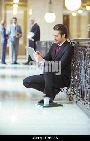 Lawyer doing work on digital tablet in courthouse - Stock Photo