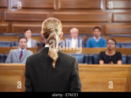 Lawyer pleading case to jury in court - Stock Photo