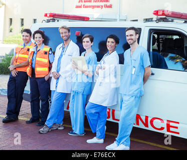 Doctors, nurses and paramedics standing by ambulance - Stock Photo