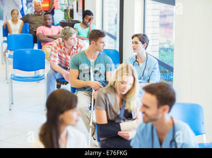 Nurse and patient talking in hospital - Stock Photo