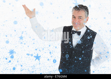 Composite image of smiling man pointing to something - Stock Photo