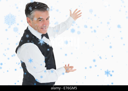 Composite image of welldressed man showing us something - Stock Photo