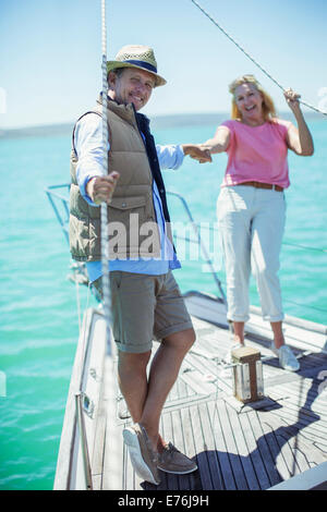Couple holding hands on boat - Stock Photo
