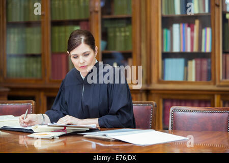 Judge doing research in chambers - Stock Photo
