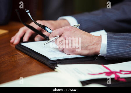 Close up of lawyers hands in courtroom - Stock Photo