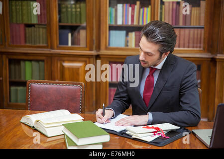 Lawyer doing research in chambers - Stock Photo