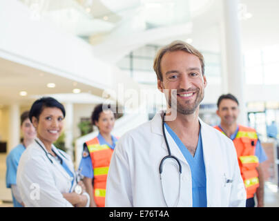 Doctors smiling in hospital - Stock Photo