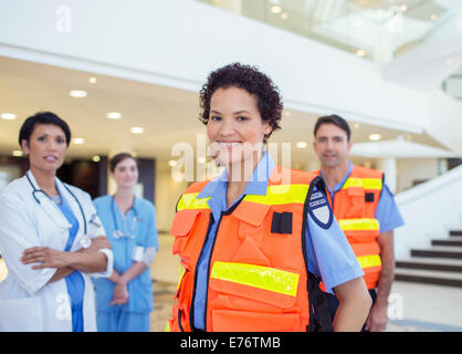 Doctor, nurse and paramedics standing in hospital - Stock Photo