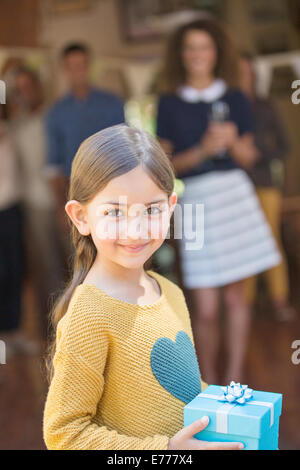Young girl holding gift - Stock Photo