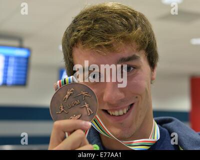 Warsaw, Prague. 8th Sep, 2014. Czech pentathlonist Jan Kuf poses with bronze medal from the Modern Pentathlon World - Stock Photo