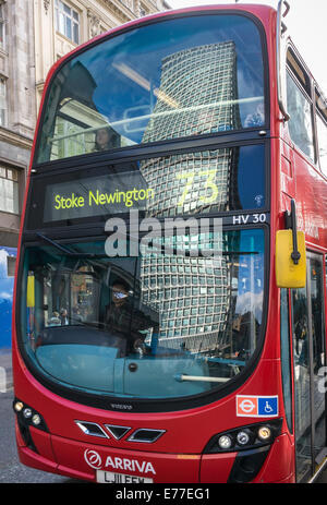 The Center Point Tower reflected in the windscreen of a London bus in New Oxford Street, London, WC1, England. - Stock Photo