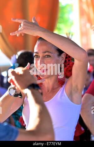 Flamenco Dancer in Traditional Dress, Annual Horse Fair, Jerez de la Frontera, Cadiz Province, Andalusia, Spain - Stock Photo
