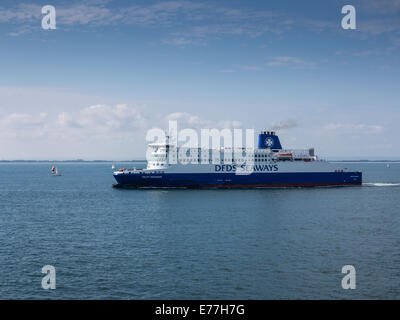 A cross-channel ferry overtaking a sailing boat in the English Channel - Stock Photo