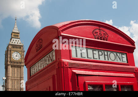London red telephone box with Big Ben in the background - Stock Photo