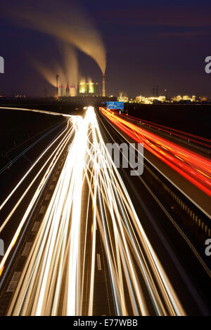 Long exposure at night, light trails on the A38 motorway, Schkopau power plant at the back, Saxony-Anhalt, Germany - Stock Photo