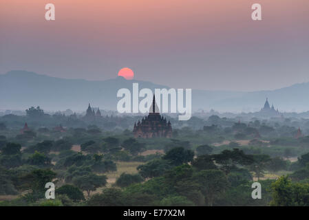 Sunset, temples, stupas and pagodas in the temple complex of the Plateau of Bagan, Mandalay Division, Myanmar or - Stock Photo
