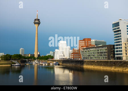 Düsseldorf  tower with buildings by Frank O. Gehry at the Medienhafen , Germany - Stock Photo
