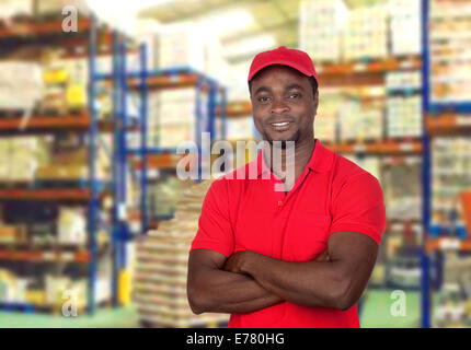 Worker man with red uniform in his workplace - Stock Photo