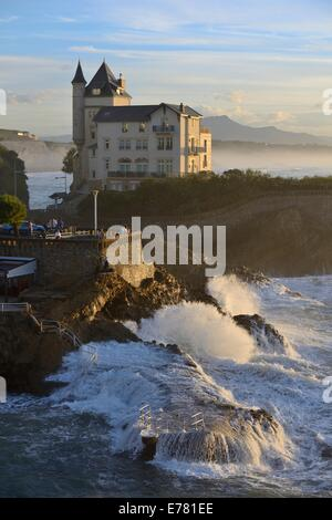France, Basque country, Biarritz, the villa Belza on the edge of the Atlantic Ocean one day swell in late afternoon - Stock Photo