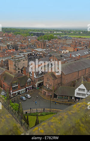 View of vast urban landscape dominated by historic buildings from high roof of cathedral in English city of Chester