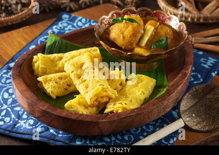 Roti jala with kari ayam. Lacy pancakes with chicken curry ...