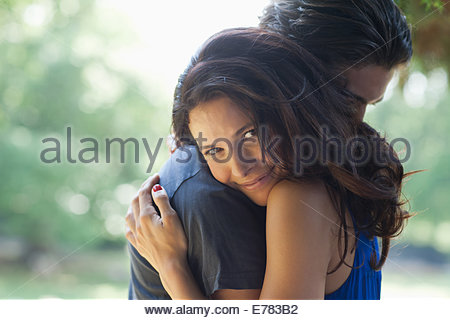 Happy couple hugging outdoors - Stock Photo